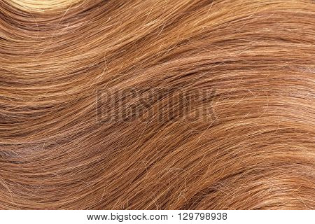 Beautiful shiny brown hair close-up. Texture background.