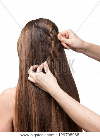 Hands parekmahera braided plait for long hair isolated on white background.