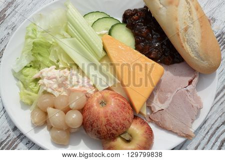 A Ploughman's lunch salad mixed food platter