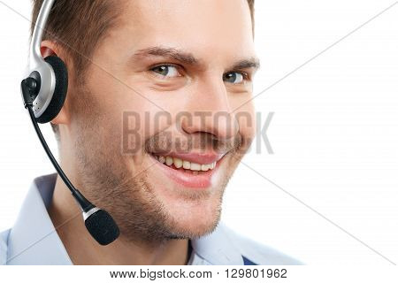 Close up portrait of male face. The operator is wearing headset and smiling. He is standing and looking at camera happily. Isolated and copy space in right side