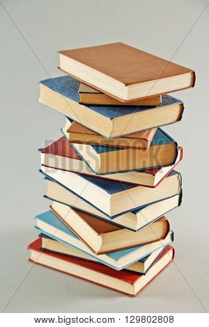 Stack of  books on grey background
