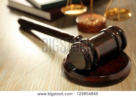 Gavel on wooden table, close up