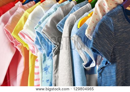 Kid's clothes on hangers, closeup