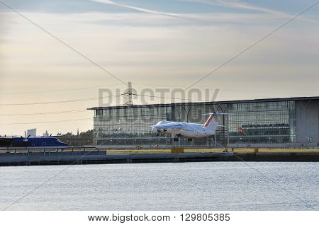 View of an airplane taking off from the London City Airport UK