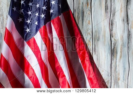 US flag on wooden background. Flag with stars and stripes. Country of great people. Banner of proud nation.