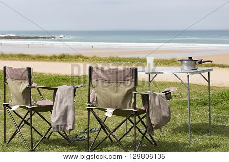 Picnic table lunch on grass sea view nobody France Normandy