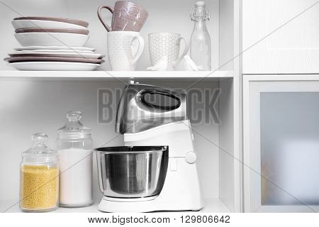 Tableware and kitchenware on a shelves