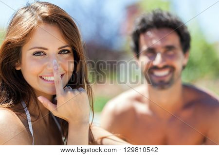 Woman applying sunscreen on her nose