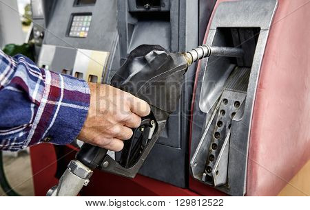 Mans Hand Putting A Credit Card In The  Atm At A Gas Pump