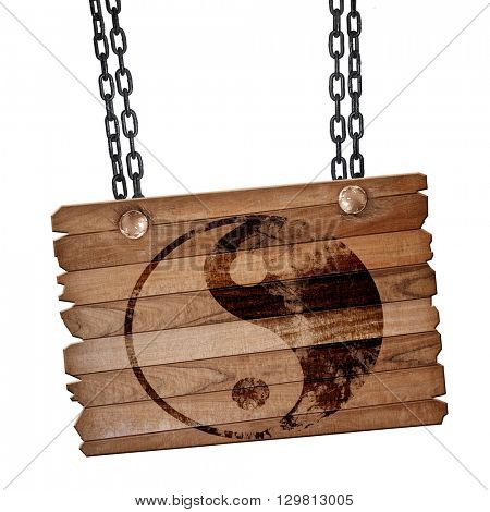 Ying yang symbol, 3D rendering, wooden board on a grunge chain