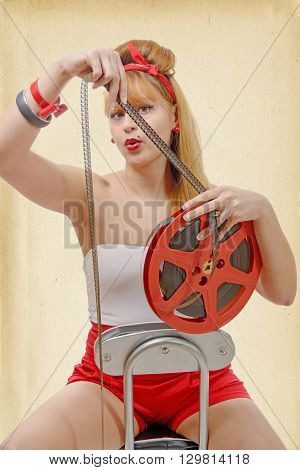 a sexy pin-up girl with a film reel