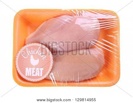 Packed pieces of chicken meat, isolated on white