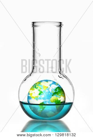 Flask with blue fluid and small Earth planet inside isolated on white