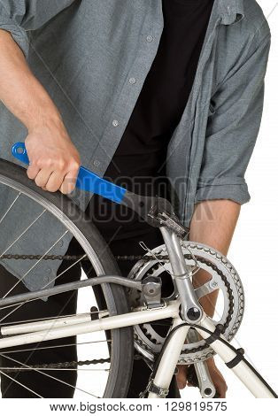 Man fixing pedals on a bicycle over white background