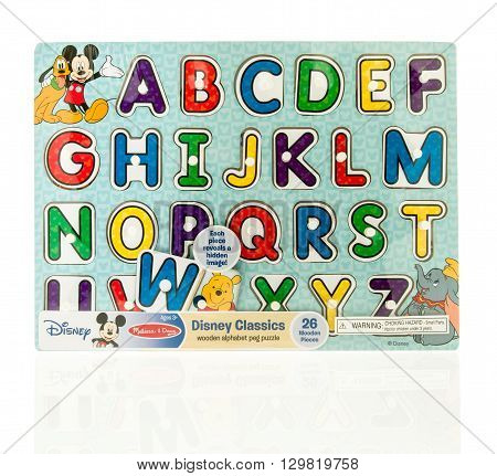 Winneconne WI - 15 May 2016: Package of a Disney classic alphabet puzzle on an isolated background