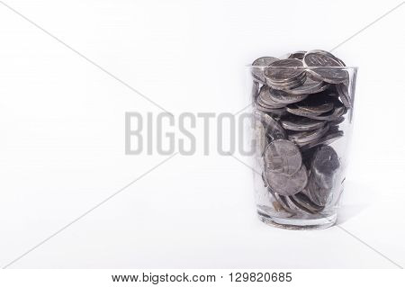 Stack Of Coin Inside Of Glass On White Background