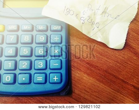 Utility bill and calculator on office table, Vintage style