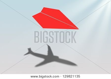 Paper airplane casting shadow of a jetliner - Vision and aspirations concept