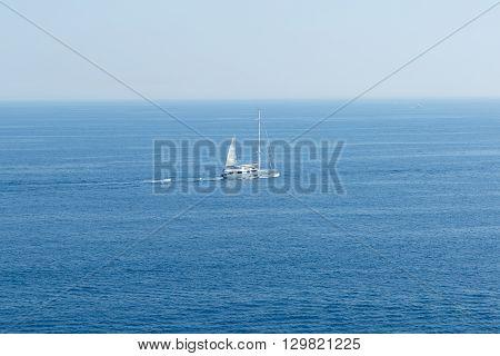 White sailboat on the blue Mediterranean Sea