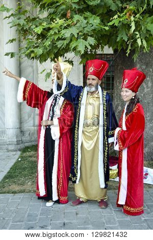 Istanbul Turkey - June 21 2012: Tourists in Istanbul Topkapi palace garden posed with the Ottoman Empire Sultan clothes.Clothing style and sultans of the Ottoman sultans.