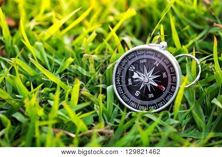 Compass on the field. conceptual of global travel , tourism and exploration, with copyspace