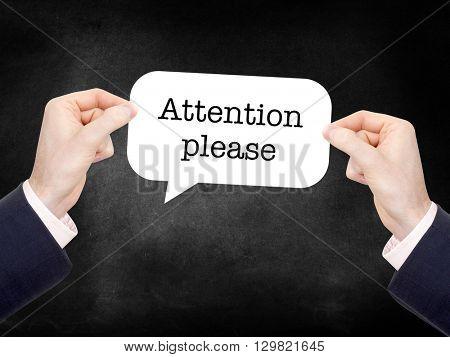 Attention please written on a speechbubble