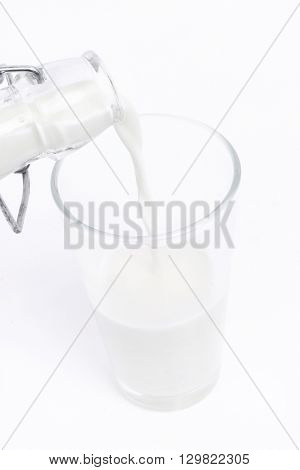Drink. Milk being poured from the bottle