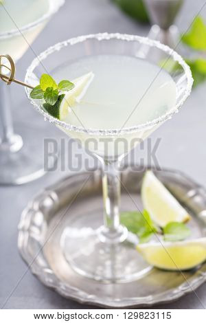 Lemonade martini cocktail garnished with lime and mint