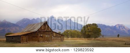 Panoramic image of the Mormon barn with backdrop of Grand Teton National Park.