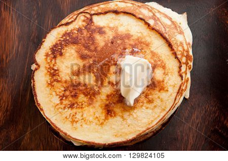 a stack of hamemade pancakes with butter