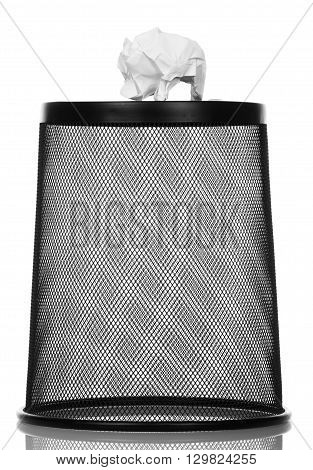 Metal trash can upside down isolated on white background.