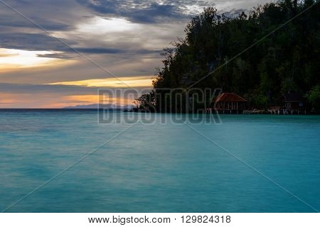 Beach On Bolilanga Island At Sunset