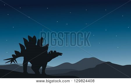 Beautiful silhouette stegosaurus at the night in hills