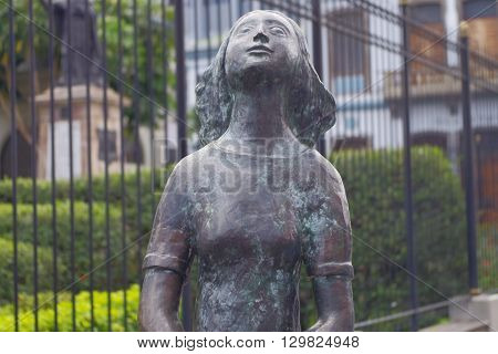 SAN JOSE, COSTA RICA - May 13: Anne Frank bronze statue located in San Jose downtown, the statue was made by the Dutch sculptor Joep Coppens.  May 13, 2016 in San Jose.