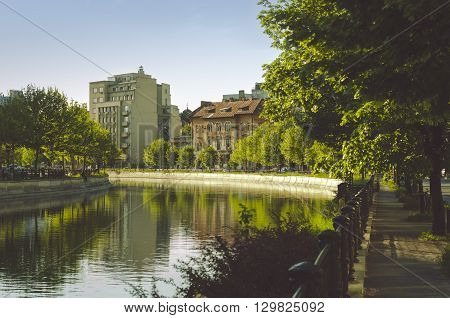 Bucharest, ROMANIA - April 22 2016: Wide view of Dambovita river and old houses in Izvor area, near the Parliament building. BUCHAREST -April 22 2016