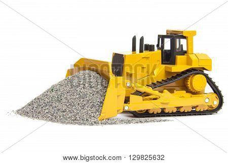 toy yellow bulldozer isolated on white background