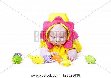 cute baby dressed in Easter flower with eggs