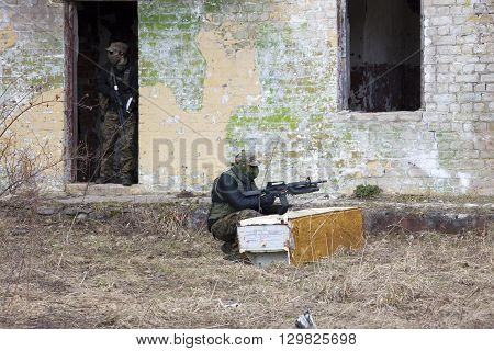 Airsoft players are holding position in ruins