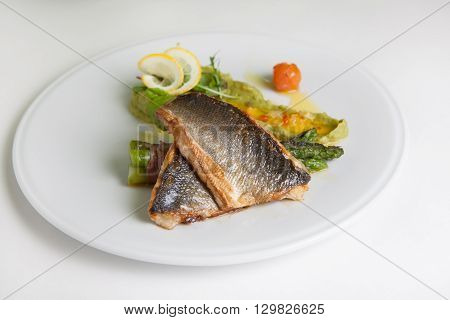 Fried fish fillet with green asparagus and pesto