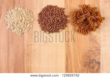 Fresh natural ingredients and products containing magnesium and dietary fiber healthy food and nutrition wholemeal pasta buckwheat brown rice copy space for text