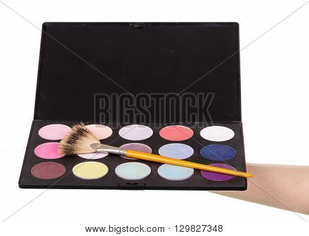 makeup artist's hand holding a palette eyeshadow isolated on white background.