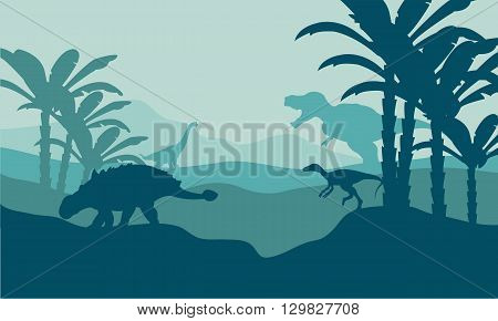 Silhouette of eoraptor and ankylosaurus with blue bakcgrounds