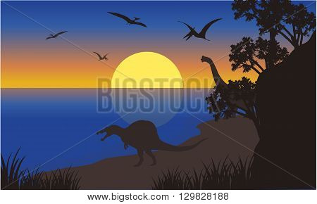 Silhouette of spinosaurus and pterodactyl at the morning