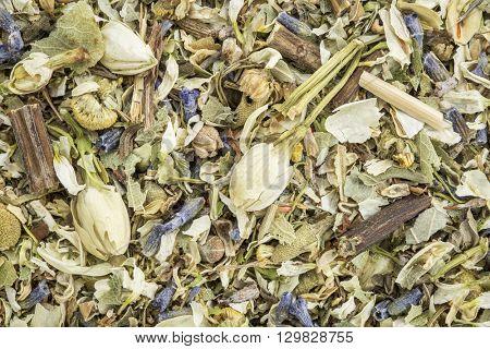 stress and anxiety herbal tea with lavender, chamomile, chrysanthemum, jasmine, lemon balm and Buddha tea - closeup background
