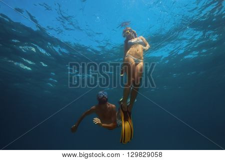 Young friends snorkeling and having fun in a tropical sea.