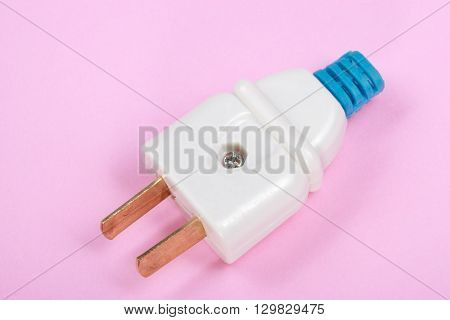 image of one American Outlet Plug on pink background