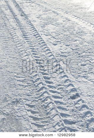 Vehicle Tyre Tracks On Snow