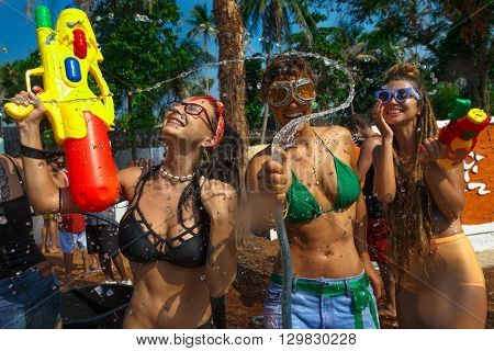 Young women with water guns has a fun