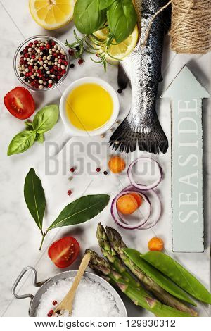 Raw rainbow trout with vegetables, herbs and spices - Health or Cooking concept