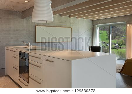 Interior of a modern chalet in cement, hob of kitchen